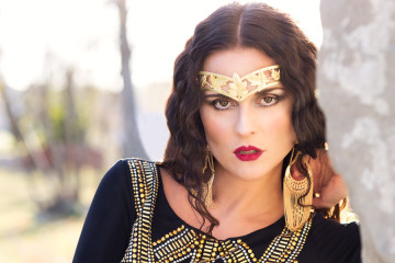 A stunning portrait of a model wearing a gold crown at Rundle Ruins in Ramsay, Calgary as photographed by Jenia Kos of Toi Et Moi Photography.