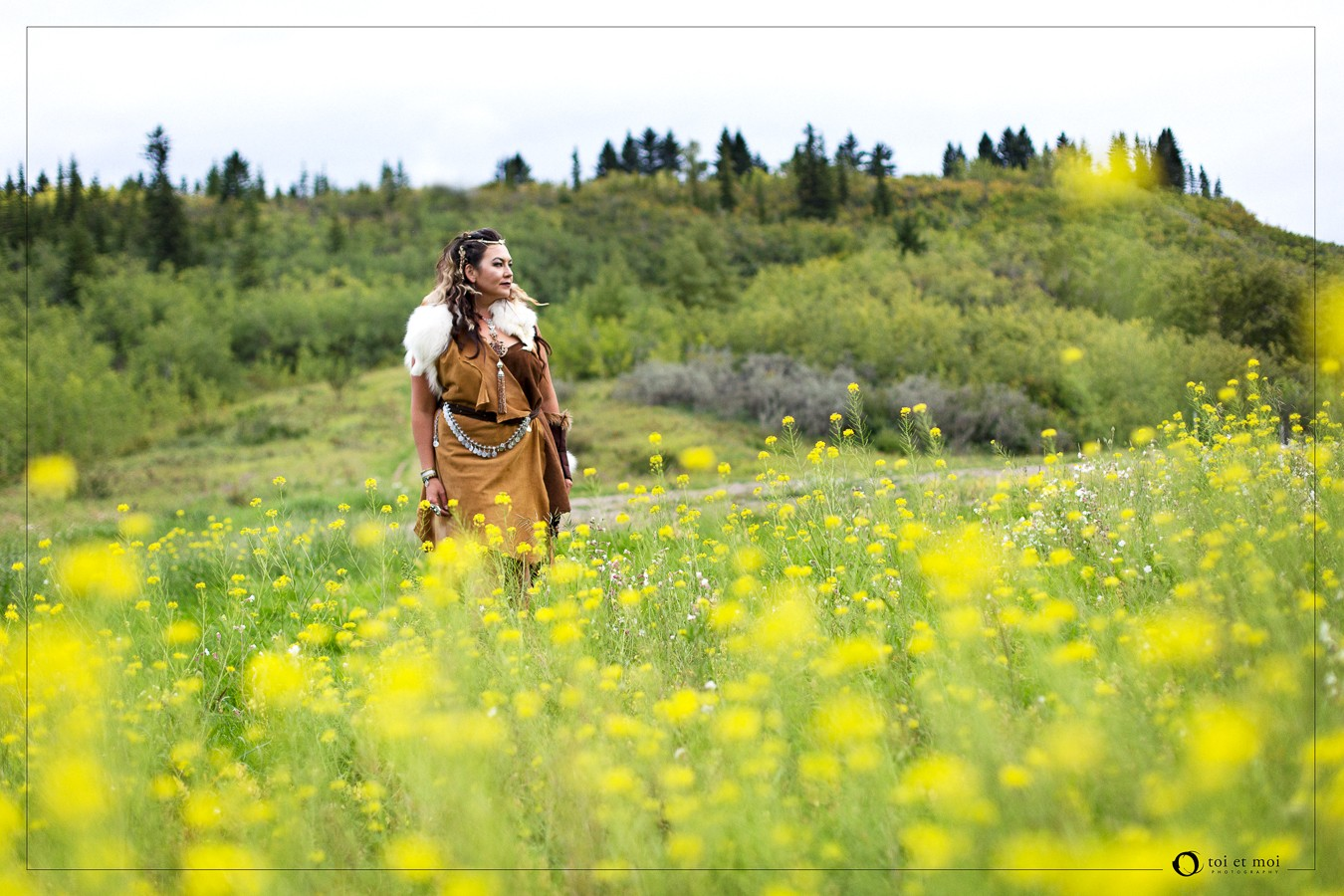 Beautiful portrait of a woman in the filed of yellow flowers